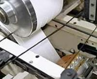 All-Electric dot adhesive application revolutionizes the bag manufacturing industry by reducing adhesive usage.
