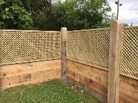 New Oak Railway Sleeper Wall Topped with Trellis Fencing
