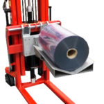 Rolling Reels from Pallet to Lifter with a Rotating Tray Attachment