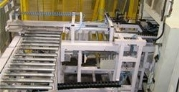 """conveyor system transports 1"""" thick chip board tiles into a mechanical press"""