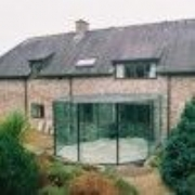 curved glass structure with faceted walls