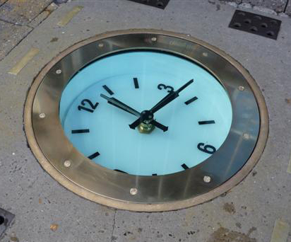 A new pavement clock for Windsor installed with time capsule hidden below.