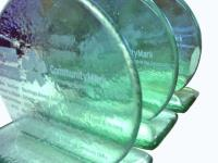 Ethical Accolades: Financial Tombstones in Recycled Glass.