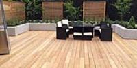 Garapa decking and Cedar screens create modern family garden