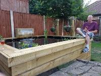 Ian's impressive raised railway sleeper pond