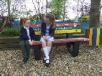 Pupils buy a Buddy Bench to promote friendship and caring at Titchfield Primary School.