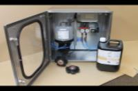 Yogurt Filling machine manufacturer in the USA uses Rotalube to apply oil precisely to the main drive chain