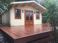 Millboard's Jarrah decking provides a vibrant transition between Summer House and Spa.