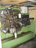 Bihler MACH05 Automatic Punching & Forming Machine with 6 slides, 25-ton press station. Serial No. 21222, Year of Manufacture: 1974 - Rebuilt in 1997 with Bihler P-CNC 200 controls, cabinet of tooling and spares