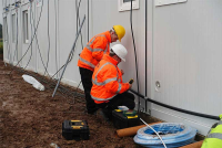 Installers Of Cabin Showers On Construction Sites