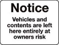 Vehicles and contents are left here entirely at owners risk sign