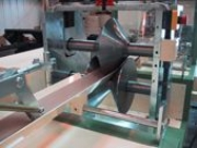 Accurate length carboard tube production