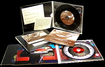 Vinyl CDs in record-style card sleeves with outer printed wallets