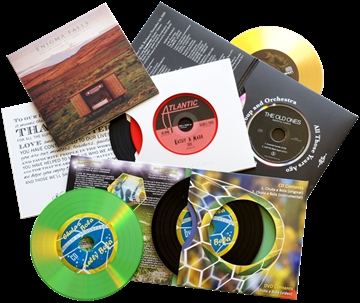Vinyl CDs in double record-style four page card sleeves