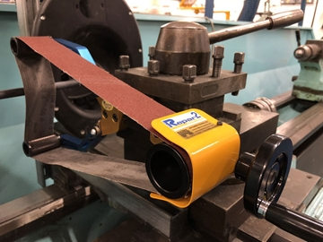 Safety guards for sawing machines