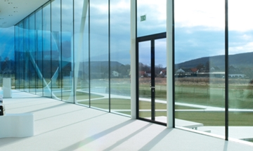 Integrated all-glass systems single action door