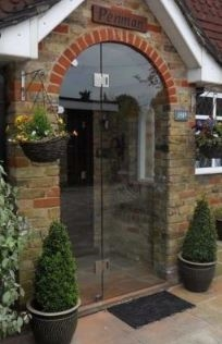 Bespoke Frameless Entrance Doors
