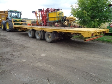 Used 32FT Tri-Axle Flat Bale Trailer